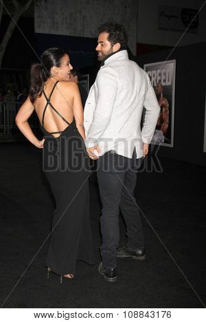LOS ANGELES - NOV 19:  Emmanuelle Chriqui, Adrian Bellani at the