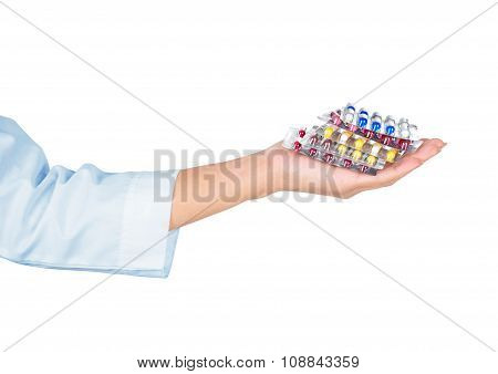 Hands Holding Pills On White Background