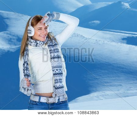 Portrait of pretty cheerful woman spending winter holidays in the snowy mountains, looking away, active lifestyle, happy Christmastime