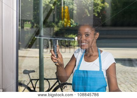 Woman Cleaning Glass From Outside