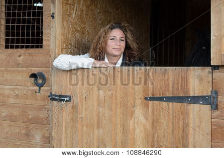 Smiling Woman Standing In Stable