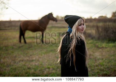 young beautiful girl in a stable, outdoors