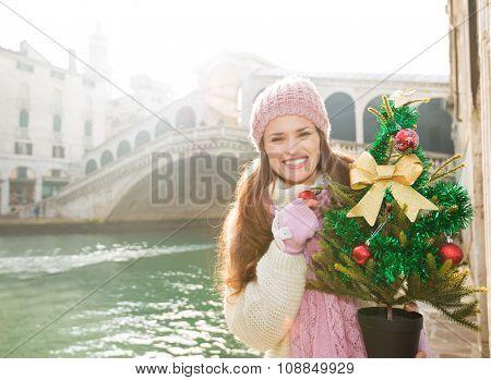 Smiling Woman With Christmas Tree Near Rialto Bridge In Venice