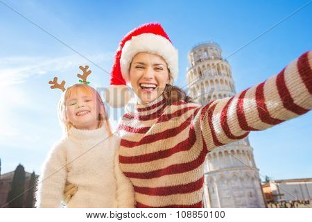 Mother In Christmas Hat Taking Selfie With Daughter In Pisa