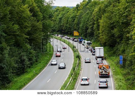 A light traffic jam with rows of cars. Traffic on the highway