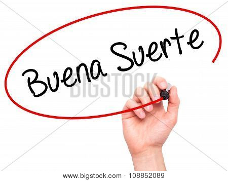 Man Hand writing Buena Suerte ( Good Luck in Spanish) with marker on visual screen.