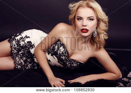 Gorgeous Woman With Blond Hair Wears Luxuriou Dress And Bijou