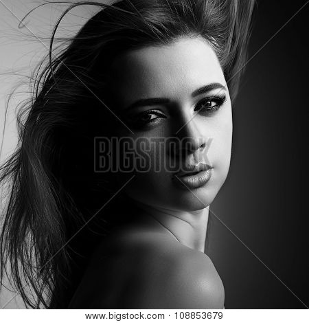 Mystic Young Woman With Passion Lips And Smokey Eyes Looking Sexy. Black And White Portrait. Art
