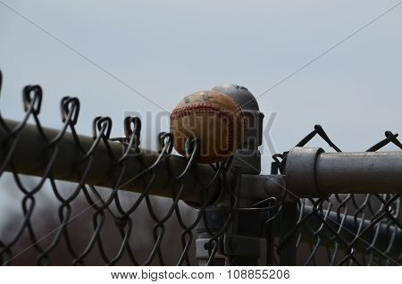 Baseball on a fence