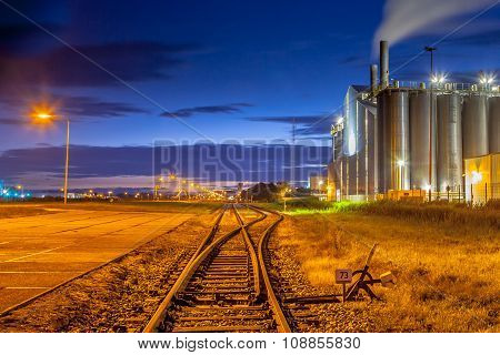 Railroad Switch In Colorful Industrial Area
