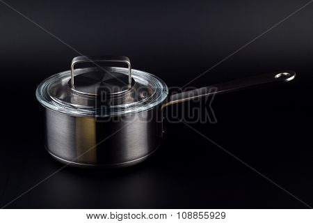 Kitchen Pot On A Black Background