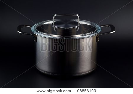 Stainless Pan On A Black Background