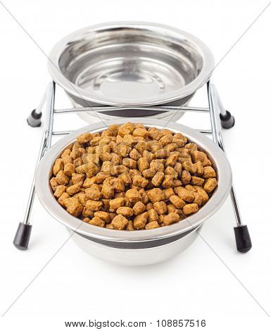 Dry Food For Pets With Water In Metal Bowls