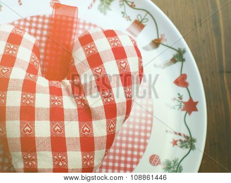 Christmas heart on wooden table