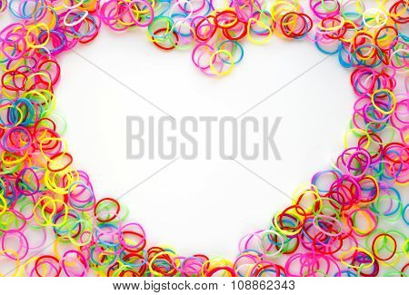 Colored rubber bands for weaving accessories on a white background