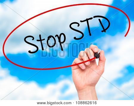 Man Hand writing Stop STD (Sexually transmitted diseases) with marker on visual screen.