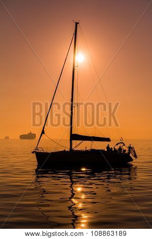 Sailing Boat Before Sunset Time, In Tranquil Sea Water