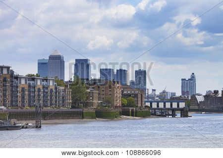 London Docklands skyscrapers view with waterfront promenade