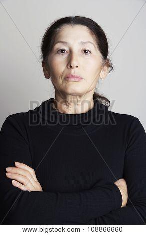 Serious asian woman