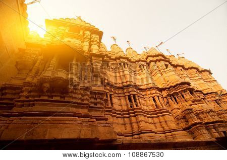 Ancient sandstone made Hindu Temple inside Golden fort of Jaisalmer, Rajasthan, India with beautiful sunlight.