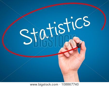 Man Hand writing Statistics with marker on visual screen.
