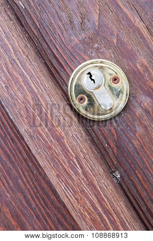 Wooden Door With A Keyhole Brass