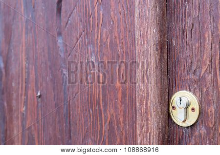 Part Of The Wooden Door Brown Close-up With Brass Keyhole
