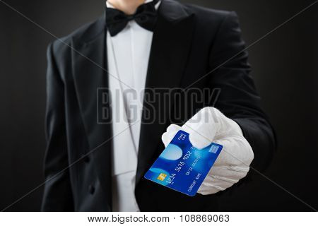 Midsection Of Waiter Holding Credit Card