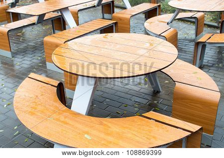 Wet Round Outdoor Cafe Tables On The Street