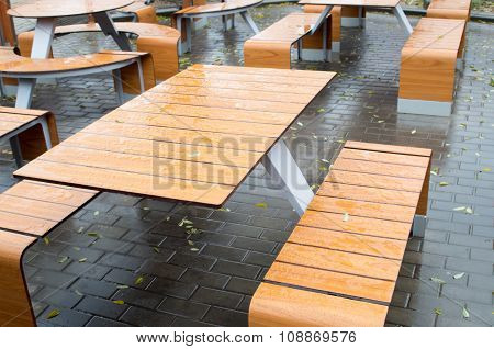 Wet Outdoor Cafe Tables On The Street