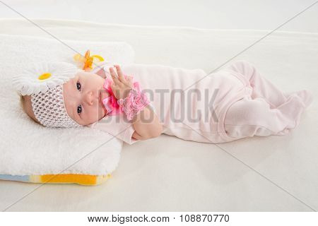 The Two-month Girl Lying On The Bed