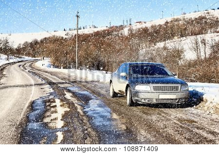 dirty car on the road. Winter snowfall