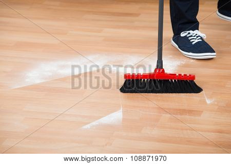 Man Sweeping Hardwood Floor
