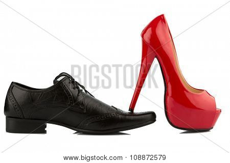 ladies shoe on men's shoe, symbol photo for separation, divorce and conflict