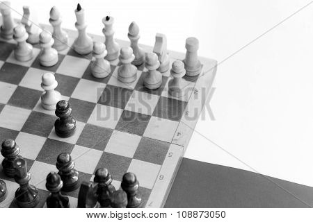 black & white checkerboard with figures on black white background