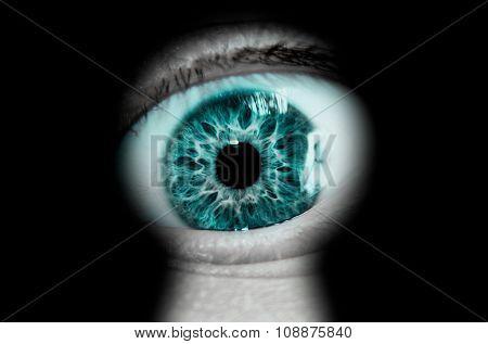 Futuristic green eye looking through a blurred keyhole