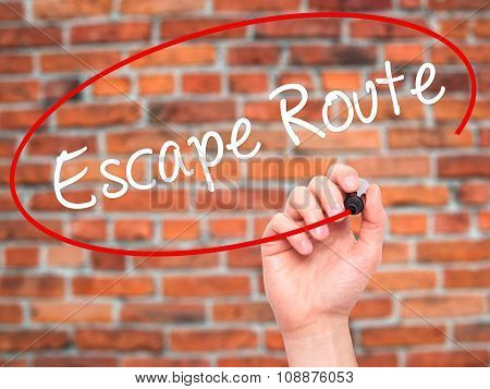 Man Hand writing Escape Route with black marker on visual screen.