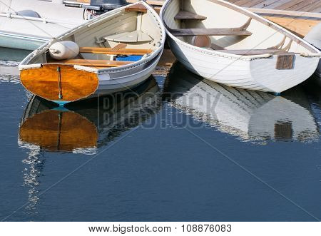 White Rowboats Reflecting in Water