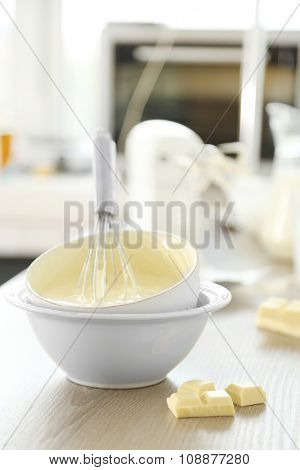 Cooking buttery cream on kitchen
