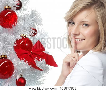 portrait of attractive  caucasian smiling woman isolated on white studio shot looking at camera new year christmas tree balls