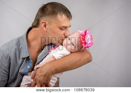 Happy Dad Kissing A Two-month Baby Daughter