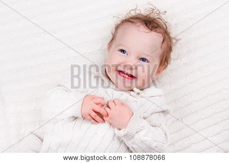 Baby Girl On Knitted Blanket