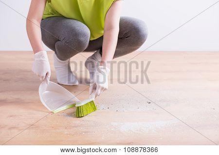 Housekeeper Sweeping Wooden Floor