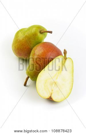 two and half ripe pears on white background