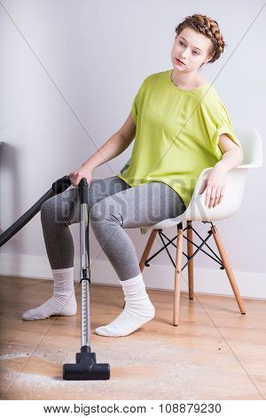 Exhausted Housewife With Vacuum