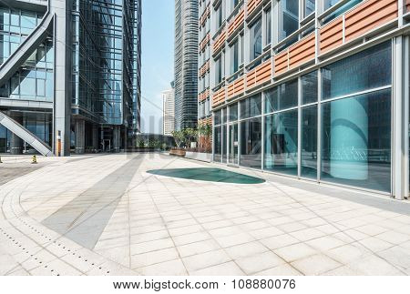empty ground in front of modern buildings