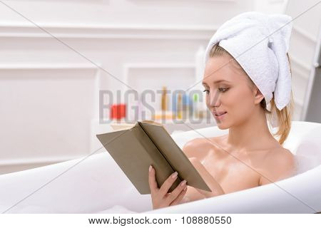 Attractive young woman taking a bath