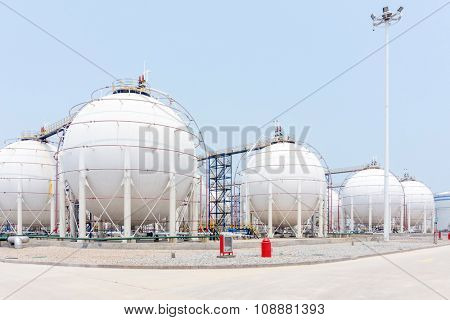 oil tanks in oil depot in clear sky