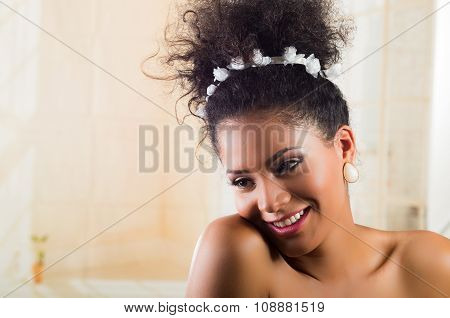 Beautiful exotic young girl wearing a floral hairband