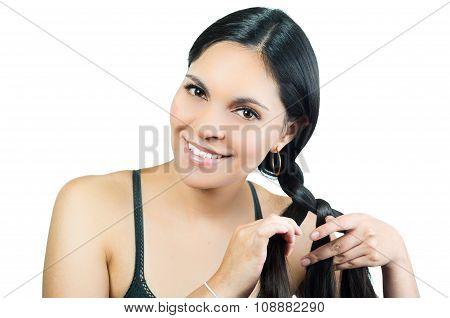Beautiful young brunette girl braiding hair